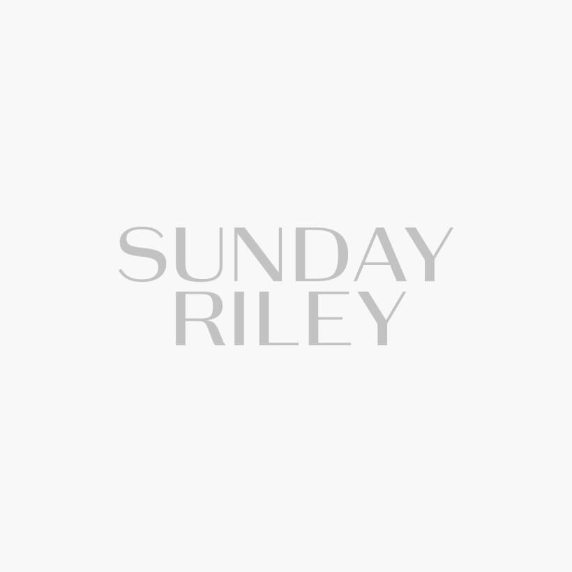 A swatch of Sunday Riley skincare products.